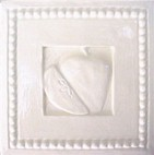 handmade ceramic tile with a high relief shell design and one color glaze