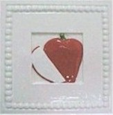 handmade ceramic tile with a high relief apple design and a multi-colored glaze