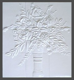 handmade nine panel ceramic tile mural with a high relief floral design and a one color glaze
