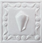 handmade ceramic tile with a high relief shell design and a one color glaze