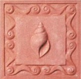 handmade terra cotta ceramic tile with a shell design and a clear matte or gloss glaze