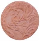 handmade terra cotta ceramic tile with a high relief dragon design and a clear gloss or matte glaze