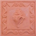 handmade terra cotta ceramic tile with a shell design and a clear gloss ot matte glaze
