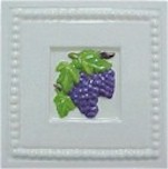 handmade ceramic tile with a high relief grape design and a multi-colored glaze