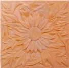 handmade terra cotta ceramic tile with a high relief flower design