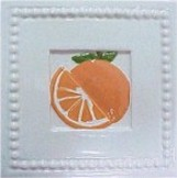 handmade ceramic tile with a high relief orange design and a multi-colored glaze