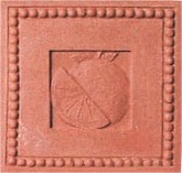 handmade ceramic terra cotta tile with a shell design and a clear gloss or matte glaze