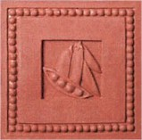 handmade terra cotta ceramic tile with a high relief shell design and a clear matte or gloss glaze