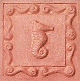 handmade terra cotta ceramic tile with a shell design and a clear gloss or matte glaze