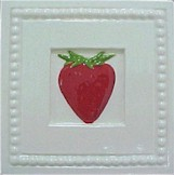 handmade ceramic tile with a high relief strawberry design and a multi-colored glaze