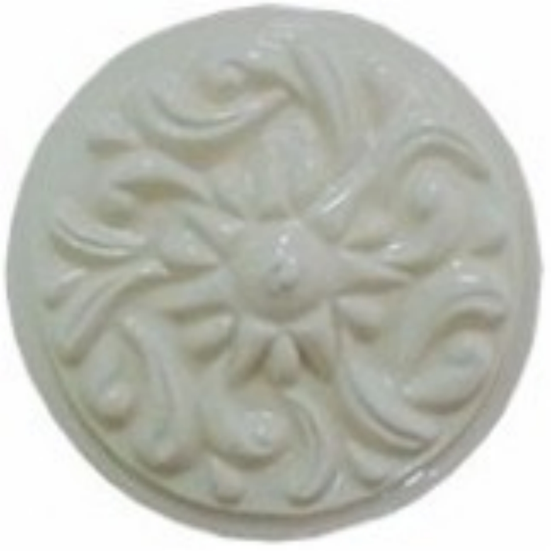 handmad circle ceramic tile with a high relief circular design and a one color glaze