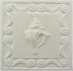 handmade ceramic tile with a high relief shell design and a one colr glaze