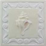 handmade ceramic tile with a high relief shell design and a multi-colored glaze