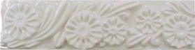 handmade designer trim piece ceramic tile with a high relief design and a one color glaze