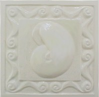 handmade ceramic tile with a high relief design and a one color glaze