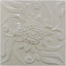 handmade ceramic tile with a high relief flower design and one glaze colors